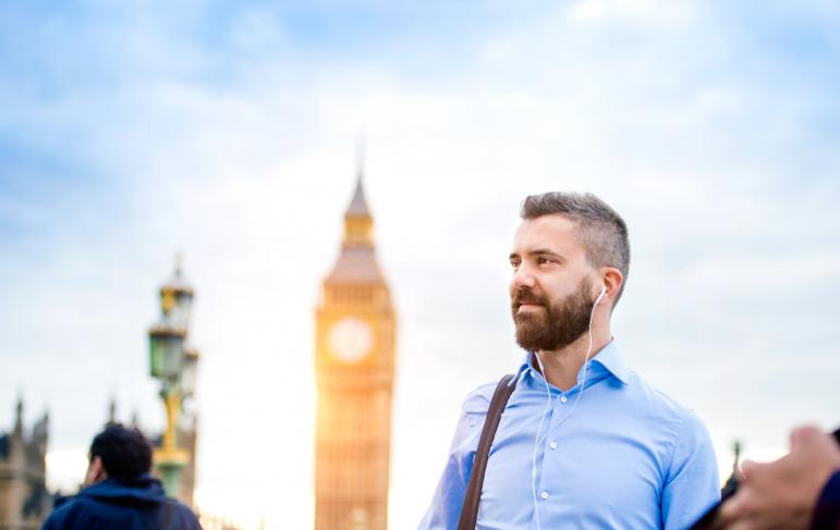 Tourist on Westminster bridge thinks about civil partner visa application through lawyers
